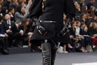 British model Delevingne presents a creation by German designer Lagerfeld for French fashion house Chanel as part of his Fall-Winter 2013/2014 women's ready-to-wear fashion show during Paris fashion week