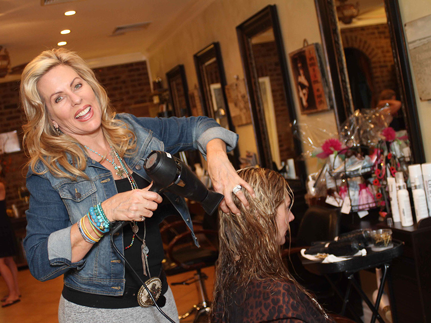 Deena Von Yokes, master stylist and colorist during a hair demo