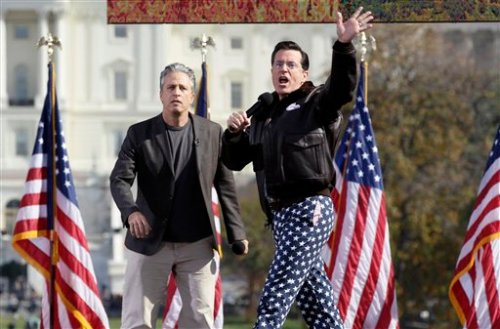 Comedians Stephen Colbert, right, and Jon Stewart perform in front of the U.S. Capitol during their Rally to Restore Sanity and/or Fear.