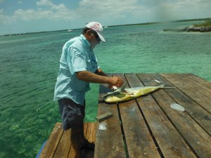 Garth Albury cleaning the Mahi