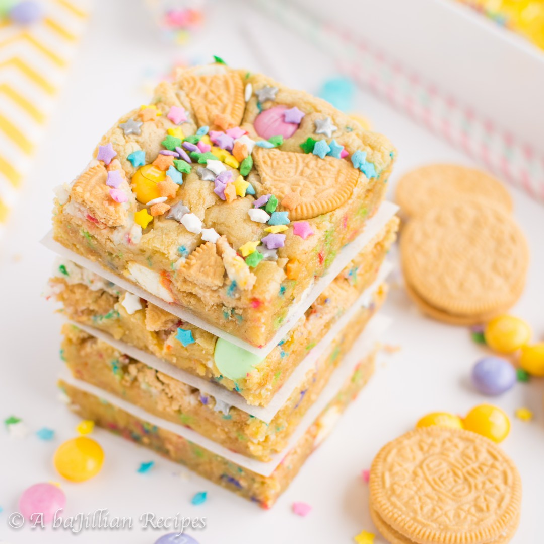 Soft-baked cake batter cookie bars loaded up with Golden Birthday Cake Oreos, Vanilla Cupcake white chocolate M&Ms, and of course, sprinkles!