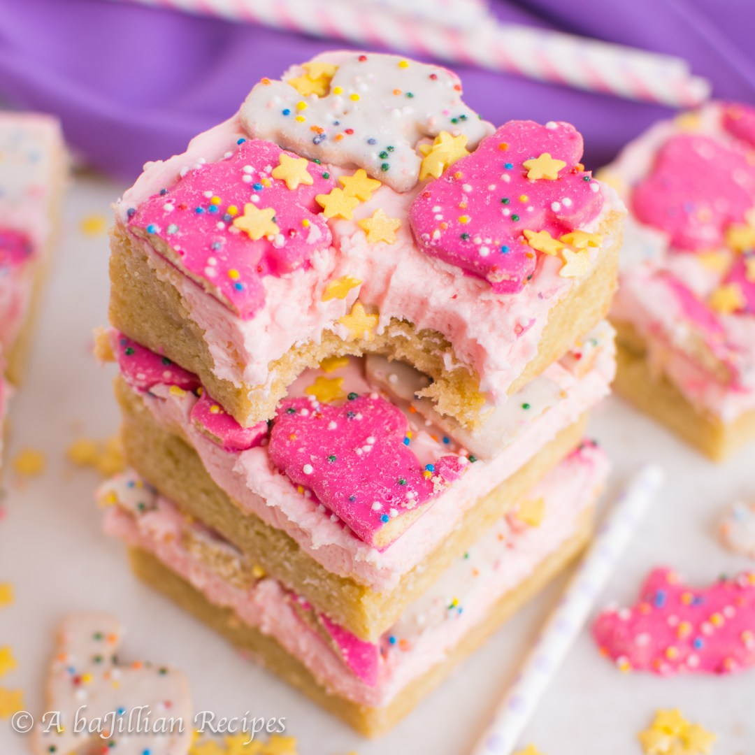 Soft and chewy cookie bars frosted with a thick layer of fluffy buttercream and topped with those irresistible Circus Animal cookies!