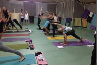 Heather Eldridge practicing yoga at a Lino Miele workshop at Kovolam, India.
