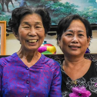 Ho Thi Ich (left) with one of her other children.