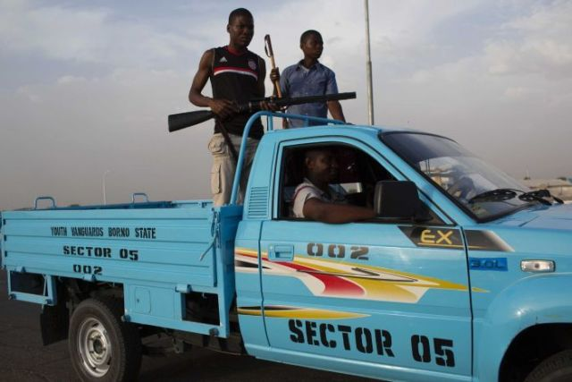 Members of Civilian Joint Task Force on patrol in Maiduguri.