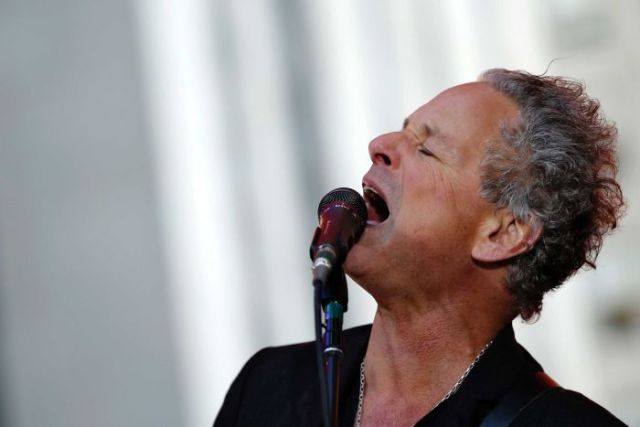 Lindsey Buckingham singing passionately.