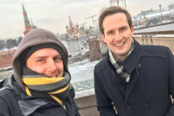 Selfie of ABC camera operator Tim Stevens and Europe correspondent James Glenday with Russia's St Basil's Cathedral.