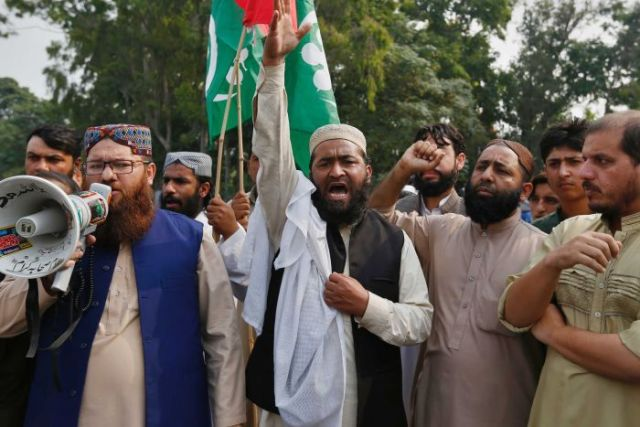 Supporters of a Pakistani religious group chant slogans during a protest after a court decision