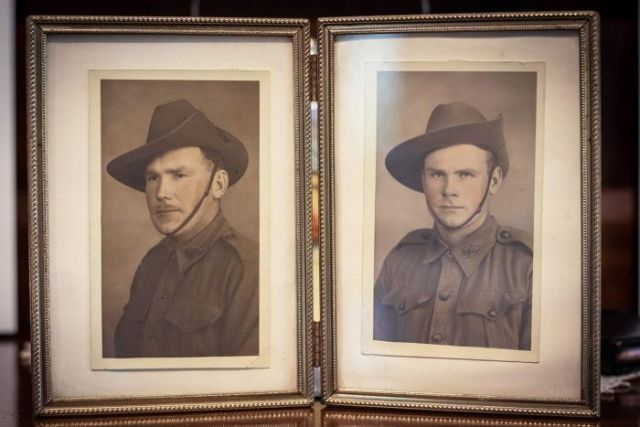 Photos in frames of WWII Australian soldiers James and Edley Simmons, dressed in their uniforms.