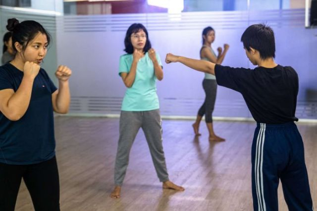 A group of women taking a class at the Myanmar Women's Self Defence League.