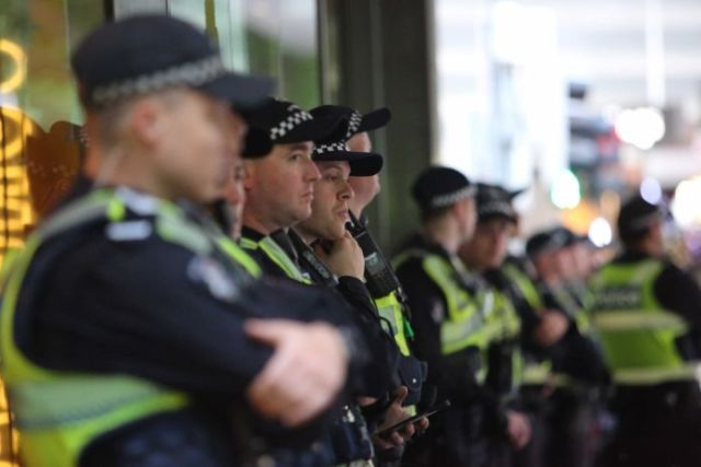 A line of uniformed police in central Melbourne.