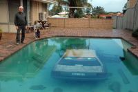 A car lying at the bottom of backyard pool in Perth after ...