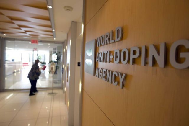 A woman walks into the head office for the World Anti-Doping Agency (WADA) in Montreal.