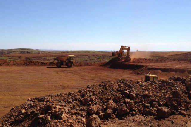 Tractors are seen in operation at a mine in the Pilbara