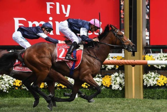 Rekindling (R) beats Johannes Vermeer (L) to win the Melbourne Cup on November 7, 2017.