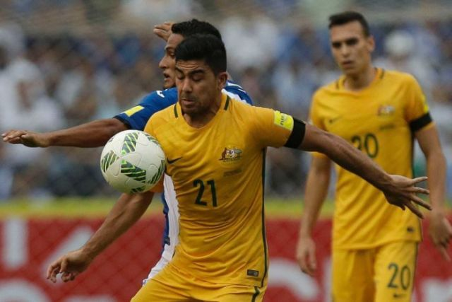 Massimo Luongo fights for the ball for the Socceroos.