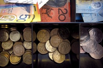 A cash drawer filled with Australian notes and coins.