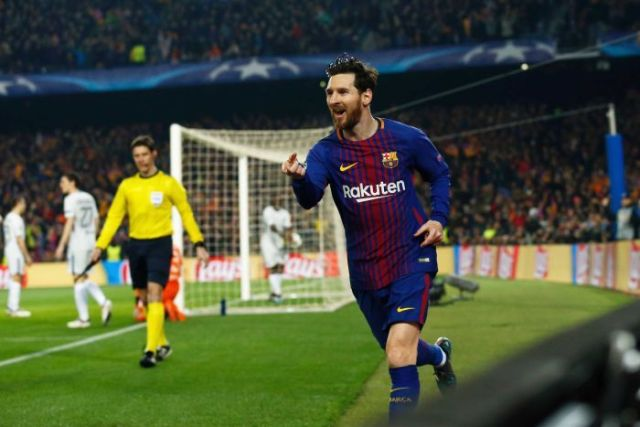 Lionel Messi celebrates Barcelona's first goal against Chelsea