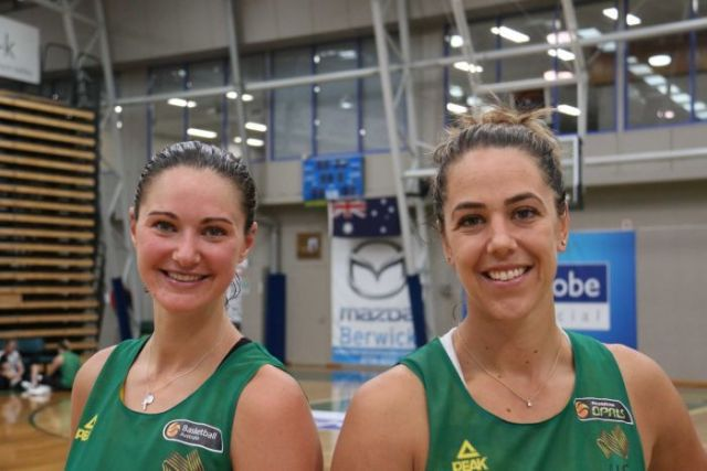 Alice Kunek (L) and Jenna O'Hea standing together at an Opals training session in Melbourne.