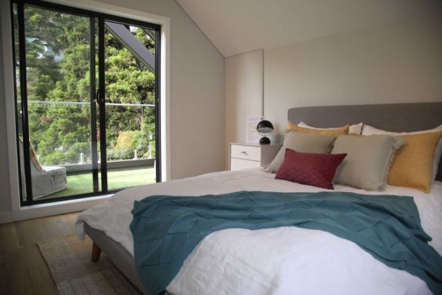 The bedroom of a display home at the Melbourne Flower and Garden.
