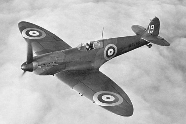 Black and white print of a spitfire flying