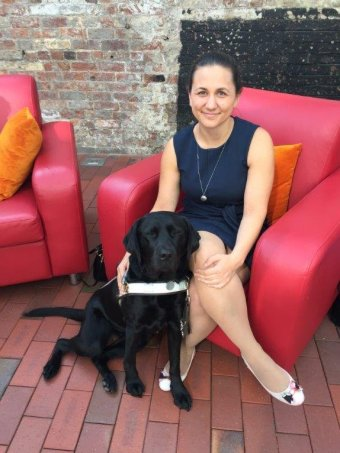 Sara Waitzer who is visually impaired with her guide dog Pepper