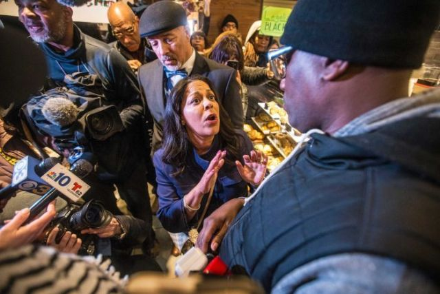 A Black Lives Matter activist confronts a Starbucks executive inside a store.