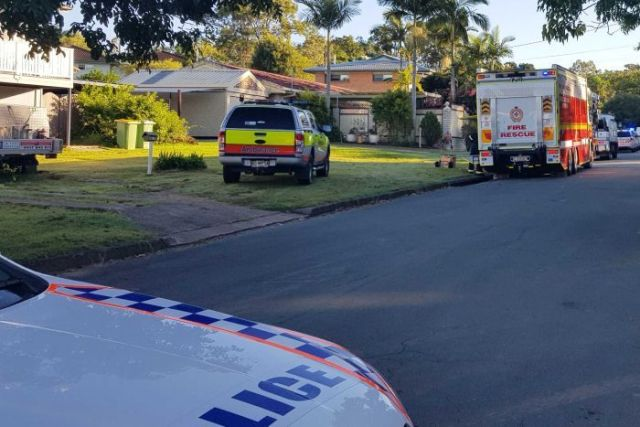 Firefighters and police outside a house fire in Everton Hills in Brisbane's north.