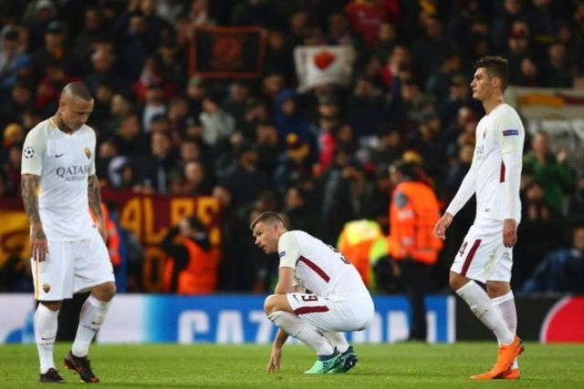 Roma's Edin Dzeko, center, reacts, defeated, at the end of the Champions League semifinal
