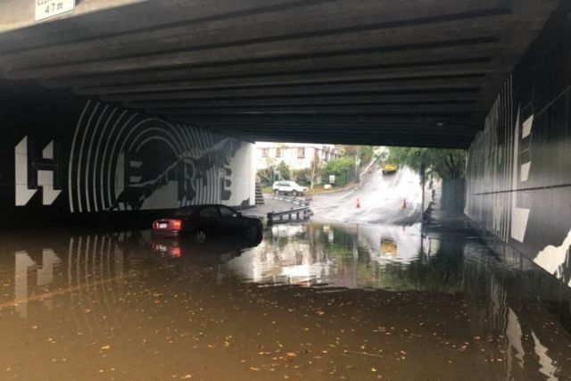 A car trapped in floodwaters at Dynnyrne in Hobart