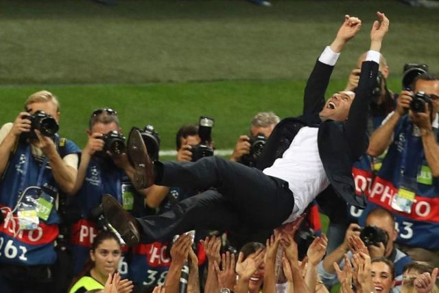 Zinedine Zidane is lifted up by Real Madrid players