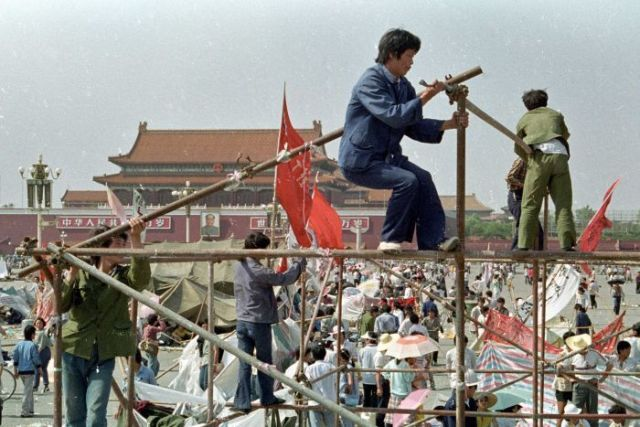 Student protesters construct a tent to protect them from the elements in Tiananmen Square.
