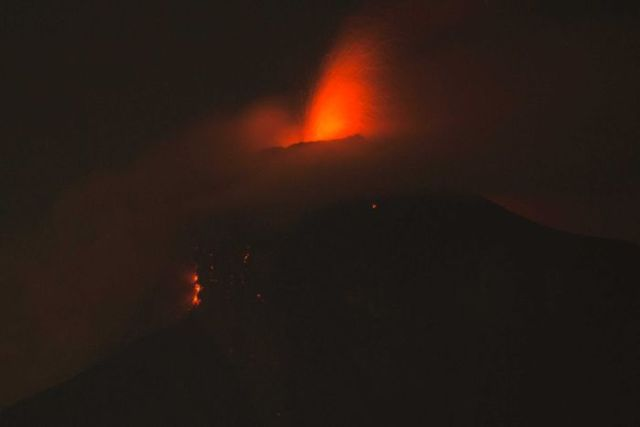 Volcan de Fuego erupts in Guatemala. Lava can be seen blowing out the top of the volcano.