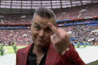 Robbie Williams gives the finger during World Cup opening ceremony