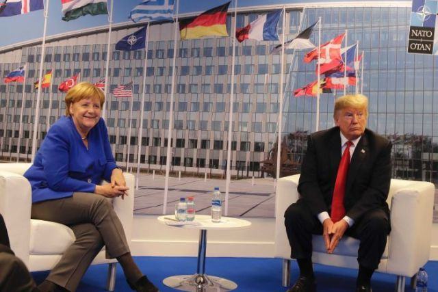 German Chancellor Angela Merkel and U.S. President Donald Trump pose for a photograph