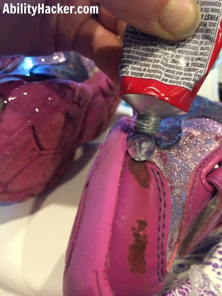 Squeeze Shoe Goo onto the shoe