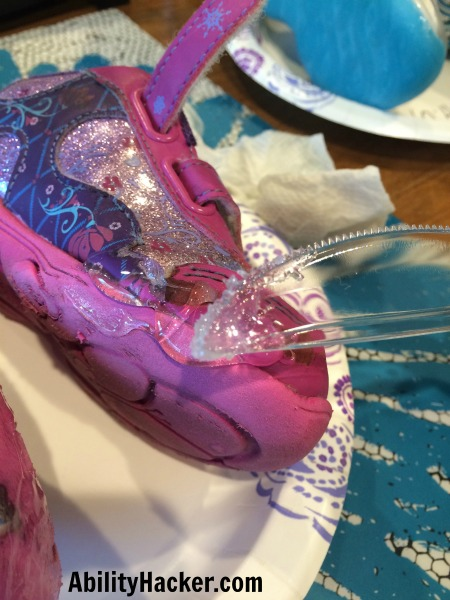 Spread the shoe goo with a plastic knife