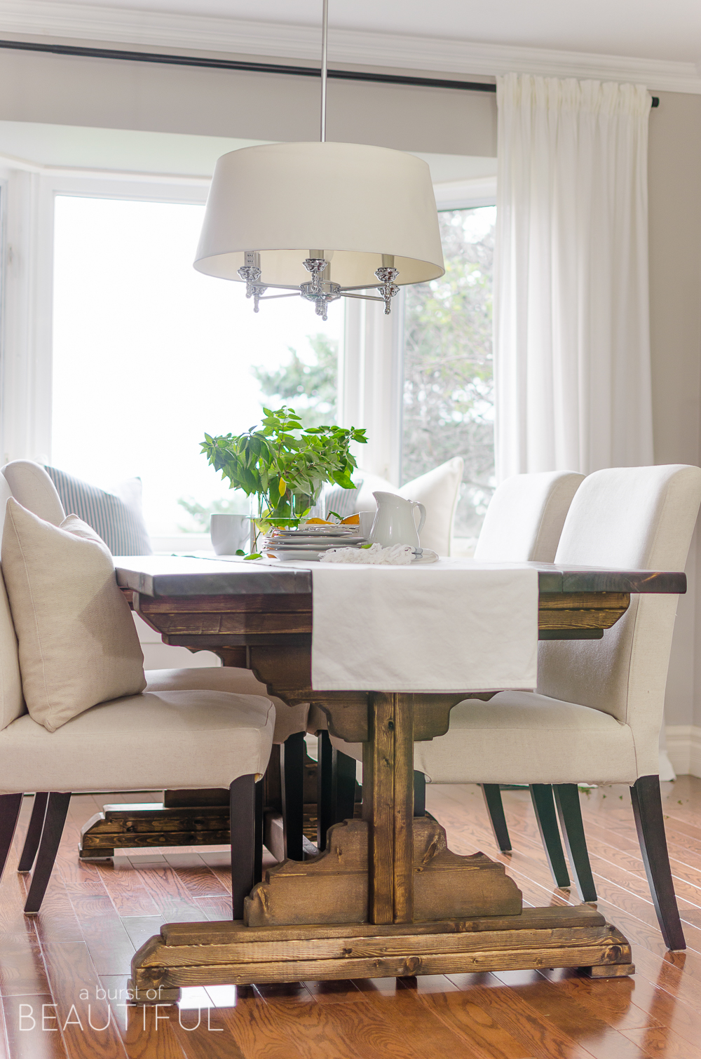 simple modern farmhouse dining room updates farm style kitchen table A bright and inviting dining room boasts simple farmhouse style with a DIY farmhouse dining table