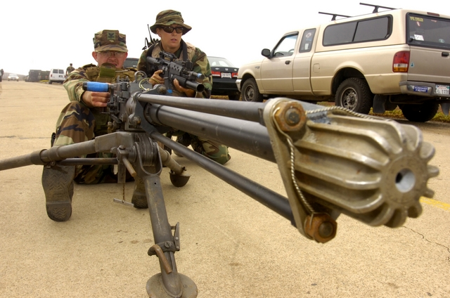 Photo Showing Soldiers or Navy Sailors with a Machine Gun - us navy master at arms