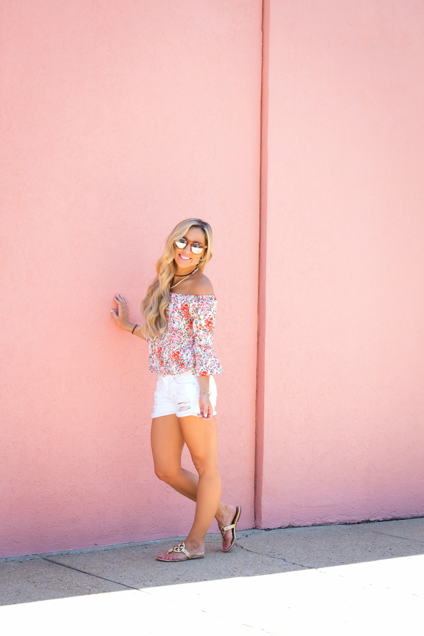 floral its top and white denim shorts