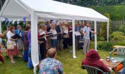 Joe leading Achoiring Voices in charity performance