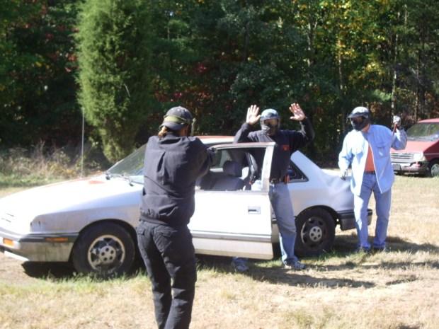 Students practice a multiple assailant carjacking scenario at TDI's Final Intensive Scenario Training class