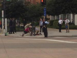 Injured person being treated on the sidewalk outside the building