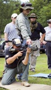 John Motil demonstrating a kneeling rifle position