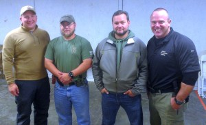 L-R Greg Peters of Peters Custom Holsters Wayne Fisher and Rob Tackett of Practical Firearms Training Me