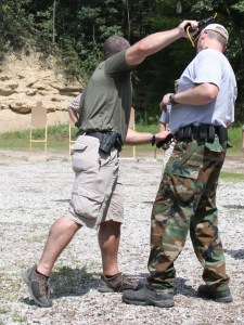 Teaching pistol whipping at a close quarters shooting class