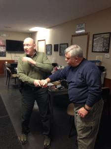 Michael de bethencourt teaching how to counter a cylinder grab.  From Handgun Comatives Facebook Page.