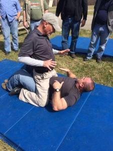 Showing some of the problems involved with shooting the snub from a grounded position as Dave Spaulding beats me up.  Image stolen from Dave's Facebook Page.