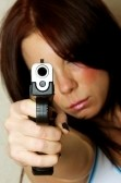 8281163-close-up-image-of-young-attractive-female-pointing-gun-focus-is-on-barrel-of-gun