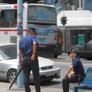 Uruguayan cop patrolling with cased long gun.